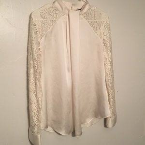 Off-white blouse with lace sleeves